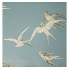 Swallows Linen Fabric. Elegant design of swallows soaring through a bright blue sky, taken from a 1930s design. Air Force Blue fabric, available online from F&P Interiors