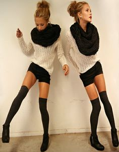 black thigh high tights, black shorts, baggy off white sweater, and big black bushy scarf.
