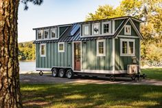 This is a custom Ridgewood Model tiny house on wheels by Timbercraft Tiny Homes. The Ridgewood Tiny House by Timbercraft Tiny Homes Tiny House Swoon, Small Tiny House, Tiny House Cabin, Tiny House Living, Tiny House On Wheels, Tiny House Design, Small House Plans, Timbercraft Tiny Homes, Tiny House Exterior