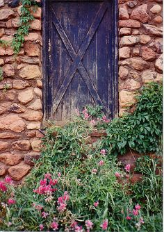 A ramble along narrow side streets in Manitou Springs resulted in finding this picturesque old door decorated with sweetpeas and some Virginia creeper.