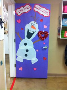 "Our class ""Love is an open door"" Valentines door starring Olaf⛄️❤️"