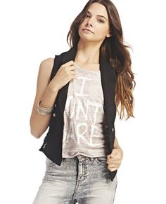 """<p>Dress up your look with this add-on piece, a French terry fleece vest designed with floral lace insets at each side, a blazer-like lapel and three metal button detail at the front. Vest is unlined and has a pointed longer front hem at each side of the open front.</p>    <p>Model is 5'9"""" and wears size small.</p>    <ul>  <li>Self: 60% Cotton / 40% Polyester</li>  <li>Lace: 90% Nylon / 10% Spandex</li>  <li>Hand Wash</li>  <li>Imported</li>  </ul>"""