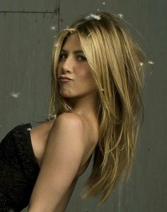 Long Layered Blond Hair - Jennifer Aniston Hairstyles I know this is for a hair style but she is my girl crush and I love this pic!
