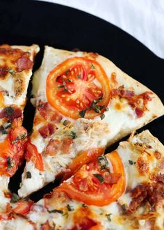 An easy homemade pizza crust smothered in garlic ranch sauce and topped with grilled chicken, bacon, tomatoes and mozzarella cheese. Mix-Up Pizza Night! Chicken Bacon Ranch Pizza, Grilled Chicken, Easy Delicious Recipes, Yummy Food, 30 Minute Meals, Tart Recipes, Yummy Appetizers, Lunches And Dinners, Mozzarella