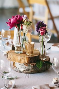 Tabletop decor rentals by Compass @compassweddings wood rounds, gold candle holder, vintage vase