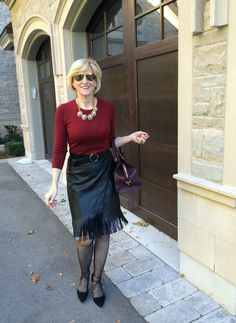Flirty fringe look fab on this black leather pencil skirt. See more photos at Fabulous After 40.