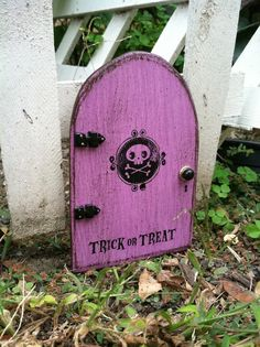 Halloween Decor Ideas Halloween FAIRY DOOR Skull and Bones #halloween #decor #ideas www.loveitsomuch.com