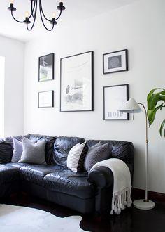 black sofa, gallery wall, cowhide, minimal Scandinavian interior design    lindsay marcella design