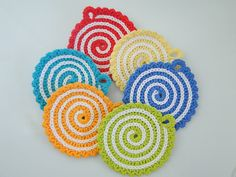 crocheted swirl motifs...what a fun, festive blanket or scarf these would make. ~ pattern