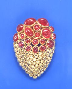 Ruby and gold pin by Suzanne Belperron, circa 1940s.