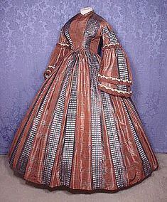 Silk day dress with pagoda sleeves, c. 1860's. The use of two different plaids to create vertical stripes is cleverly done.