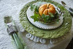 Fall tablescape: pumpkins with ivy; table knife and napkin in napkin ring