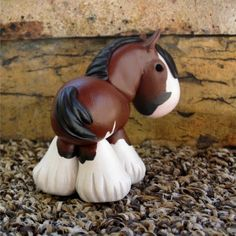 bay clydesdale / draft painted clay horse by SpottedHorseKorral. I love the way she works personality into every angle.