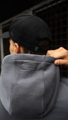 It's all in the details. The Laundered collection features subtle but stylish additions such as this hood piece. People With Green Eyes, Embroidered Badges, Tracksuit Bottoms, Muscle Training, Body Reference, Sleeveless Hoodie, Workout Shorts, Fitness Goals
