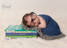 Book worm! Newborn baby wearing glasses and laying on books. #babies  #newborn #newbornphotography #baby #boy