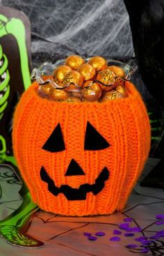 Pumpkin Bowl Cozy. A perfect Jack-o-Lantren to knit. Slip the cozy over a bowl or vase, glue on the felt features and fill with treats. Free pattern