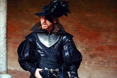 Tim Roth in black silk and leather