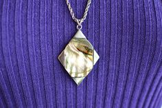 Vintage 1960s 1970s space-age silvertone metal pendant abalone shell, stamped 'Exquisite', on silvertone chain by PenelopeHeavenly on Etsy