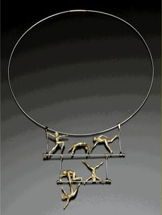 Necklace | Kim Eric Lilot.  'Signs of Life - Trapeze'.  18 karat yellow gold and Platinum cable/wire.