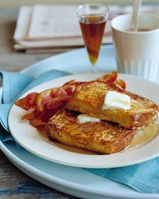 french toast, served with maple syrup, bacon and a fresh fruit salad