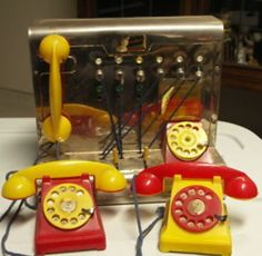 Had one very similar to this, although the phones were long gone by the time I inherited it   Vintage Tin Switchboard Operator Telephone Toy 1950's