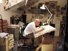 Drawing board and art equipment. Pictured is George Perez the comic book artist, I wouldn't keep him in my cave, that would be cruel...