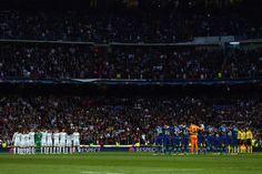 Players observe a minute of silence prior to the UEFA Champions league Quarter Final Second Leg match between Real Madrid and VfL Wolfsburg at Estadio Santiago Bernabeu on April 12, 2016 in Madrid, Spain. (April 11, 2016 - Source: Alex Grimm/Bongarts)