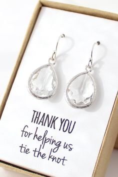 THIS LISTING INCLUDES • Clear Crystal / Silver Teardrop Earrings (model # EB1) • Gift-wrapped with note in box and name tag on outside of box MATERIALS • Clear glass • Rhodium-plated brass frame • Sterling silver ear wires (not just plated, great for sensitive ears!) SIZE • Pendant (not