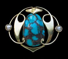 Archibald Knox brooch for Murrle Bennett. Silver, turquoise and pearl, c. 1900.