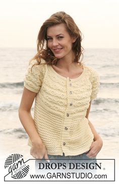 """DROPS jacket knitted from side to side with cables and pattern in """"Baby Merino"""". Size S - XXXL."""