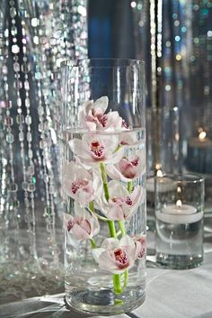 Floral Centerpiece by Southern Event Planners in Memphis, Tennessee. Memphis Tennessee, Event Planners, Floral Centerpieces, Glass Vase, Southern, Table Decorations, Celebrities, Party, Wedding