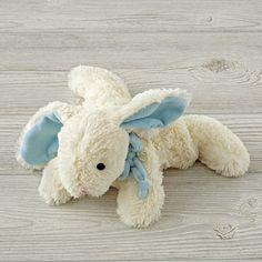 Shop Blue Bunny Stuffed Animal.  Hop on over and give this plush bunny a cuddle.  With a soft, floppy body and bean-filled paws, this bunny stuffed animal is ready for cuddling.