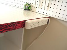 Power bar attached to the craft table......just flip a switch now to turn on my glue gun))) http://www.trendytree.com/blog/building-work-table/