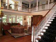 Love how the upstairs wraps around the downstairs living room!