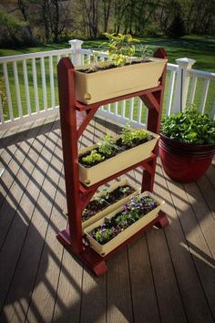 How To Urban Garden How to build a Garden Plant Stand - The plant stand shown in this instructable grows edibles in a compact vertical space. We use the planter to grow herbs and edibles on the deck close at hand to t. Garden Plant Stand, Plant Box, Diy Plant Stand, Vertical Garden Plants, Outdoor Plants, Garden Planters, Vertical Planter, Plants Indoor, Herb Garden