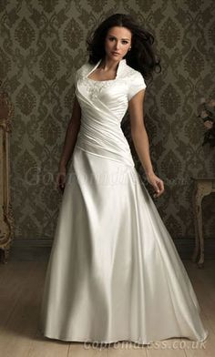 wedding dresses with sleeves...this would be my choice for a dress if it had long sleeves and ruffles.