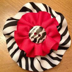 Ribbon Blossom! http://www.facebook.com/pages/Bella-Bowlicious/198451015241