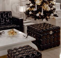 Shiny black PU storage ottomans. Olga Sismanidou / Miracles
