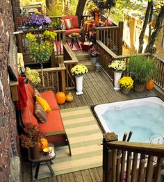 Just Add Flowers:  [Before pic another pin] This deck needed a little more life. A series of container gardens, including ornamental grasses, flowers, and shrubs added bright splashes of color. Some new furniture and a pair of outdoor rugs gave the deck additional creature comforts.