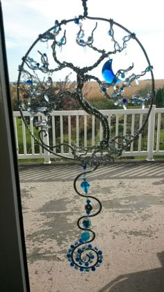 Wire wrapped Frozen Tree of life sun catcher with blue crystal moon.