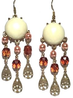 A personal favorite from my Etsy shop https://www.etsy.com/listing/541388268/gold-filigree-hammered-tear-drop