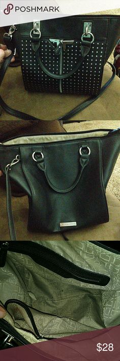 Danielle Nicole Purse Good condition But needs good cleaning inside, there is a long zip up pocket then 2 smaller pockets on the other side which one does have a hole. On each side of the bag there is a pocket. On front of the purse there is a zip down that has pockets on each side very roomy very cute. Has the long shoulder strap and regular Cary strap with the zipper  across the purse.  Has Danielle Nicole medal on back of purse. Lot of life left  15% off 3 or more Bundle plus free gift…