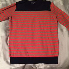 Gap sweater-navy, tan and orange Gap sweater, worn maybe 2x great condition. The top and bottom color is navy, the stripe colors tan and orange size L. I think it fits like a Medium. It's a thinner material not bulky. GAP Sweaters Crew & Scoop Necks