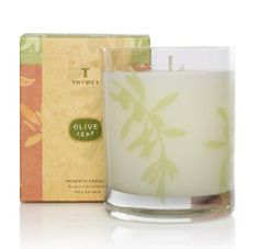 Thymes Aromatic Candle, Olive Leaf by Thymes. $27.00. A uniquely modern fusion with ties to antiquity, Thymes olive Leaf has a fragrance that is mild and healthful, lightly herbal with Sardinian laurel leaf. Burns approximately 40 hours. Burns cleanly. Scented candle in decorated glass container. Thymes guarantees the safety of products without ever testing on animals. With subtle wood notes and rich herbal infusions, Thymes Olive leaf Candle helps to restore balance whenever lit.