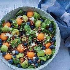 Summer salad with melon, blueberries and advocado.
