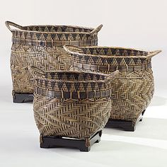 Woven baskets with wooden bases can lighten up a room with dark woods, especially if used as planter covers for palms, Norfolk Island Pine, caladium, croton, false aralia, fiddle leaf fig and tree philodendron.