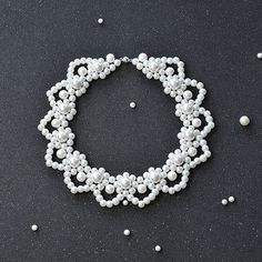 Do you have a friend who is a bride-to-be? Are you searching for pearl jewelry for wedding? Check this elegant white pearl flower statement necklace here, it won't let you down.