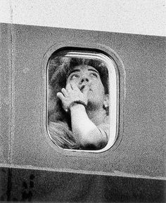 Passengers' by John Schabel. For about three years in the 90's, New York-based photographer John Schabel took on a voyeuristic project involving people seated on planes, as seen through the aircrafts' porthole windows. Unbeknownst to the anonymous flyers, the photographer would snap shots of them with a telephoto lens from a safe distance, nearly 100 yards away.
