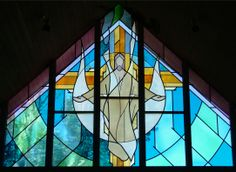 Religious Stained Glass Windows | Creative Stained Glass Studio Ltd. Denver, CO since 1973/Depicts the risen Christ with the Holy Spirit and the cross over which He conquered sin and death.