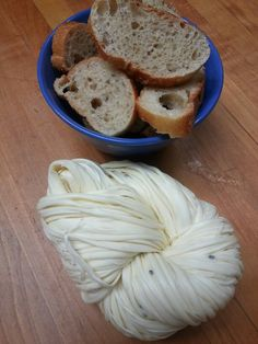 """Majdoul, the original """"cheese strings"""" from the Middle East is a mold cheese made with Nigella seeds. It is very salty so soak it in cold water to release the saltiness. Pull it apart and serve with warm pitas, savoury jams and crisp cucumbers."""